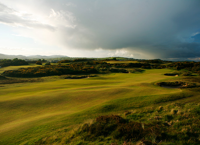 Royal County Down, Newcastle, Co. Down: No course so perfectly combines beauty and brawn as Royal County Down, Golf Magazine's sixth-ranked course in the world. The venue for the 2015 Irish Open is an 1889 Old Tom Morris design that was reworked by H.S. Colt in 1926. The unforgettable par-3 4th and par-4 9th, the latter with its blind drive, feature prickly yellow gorse, bewhiskered bunkers and views of the mountains and sea. ($83-$307; 011 44 28 4372 3314, royalcountydown.org)