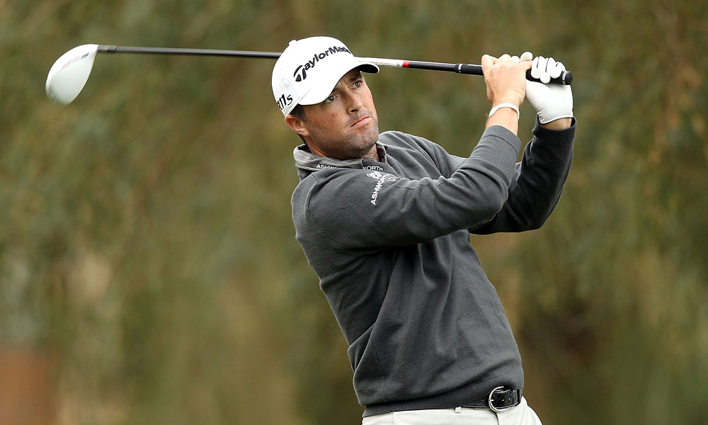 Ryan Palmer fired a seven-under 64 to take the lead before play was suspended due to darkness.