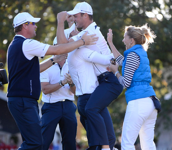 Then he jumped into teammate Sergio Garcia's arms. No. 4. He can jump fairly high.