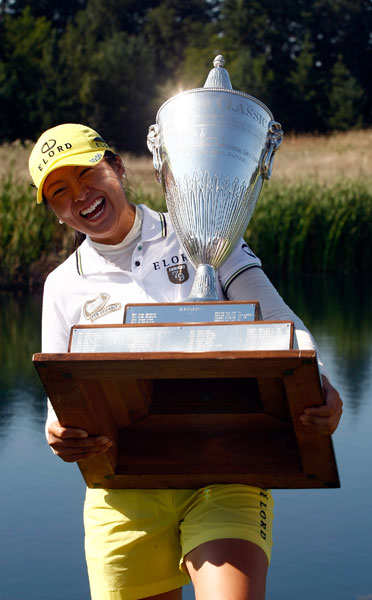 Some trophies are a little too big for their recipients, like this one M.J. Hur recieved for winning the 2009 LPGA Safeway Classic.