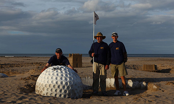Peter Bignell, center, and his small team of fellow sculptors worked on a beach near the Old Course's first fairway. (Read Alan Bastable's story.)