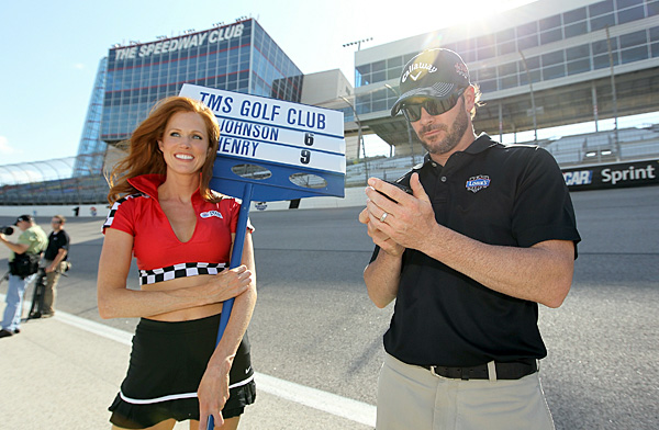 (right) joined PGA Tour player J.J. Henry in a three-event golf skills challenge at the Texas Motor Speedway in Forth Worth, Texas.