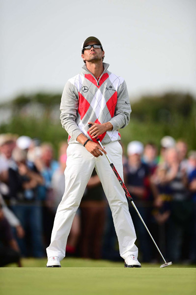 4. Adam Scott                       No best-dressed list is complete without Adam Scott. Admittedly, as a longtime Burberry endorsee who now sports the UK-based luxury brand Aquascutum, the affable Aussie has an unfair advantage over the competition. But this look from Scott's third round at the Open Championship earlier this year is my favorite of 2012, thus far. Argyle can easily look grandfatherly, but Scott's pairing of the oversized red, gray and white argyle print sweater with white trousers? Gorgeous.
