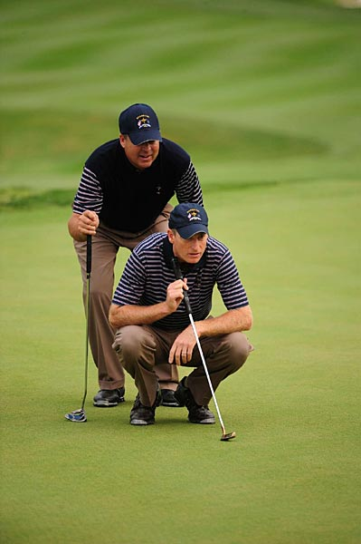 Kenny Perry, standing, and Jim Furyk won a tough match with Padraig Harrington and Robert Karlsson, 3 and 1.