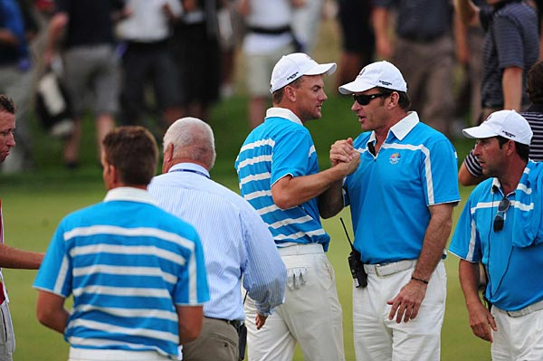 Karlsson just missed an eagle putt on 18 that would have won the match outright. Afterward, he was congratulated by Nick Faldo, the European coach.