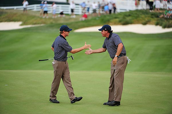 Hunter Mahan, left, and Phil Mickelson halved their match with Henrik Stenson and Robert Karlsson.