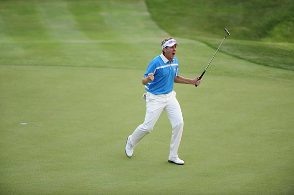 Ian Poulter's eyes nearly popped out of his sockets after making a 30-inch birdie putt on 18. He and Graeme McDowell defeated Kenny Perry and Jim Furyk. Poulter, a captain's pick, has delivered three vital points.