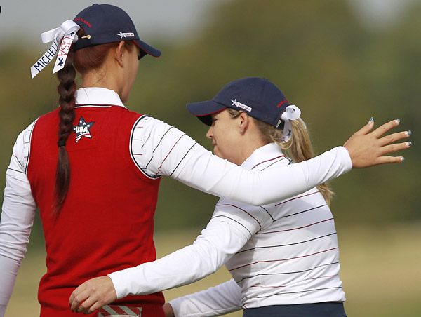 Michelle Wie and Cristie Kerr won their opening foursome match, 2 and 1, over Maria Hjorth and Anna Nordqvist.