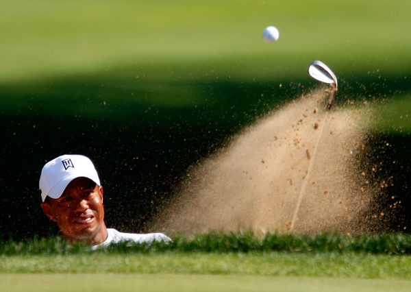 Tiger Woods, second in the FedEx Cup points race, shot a 67 to tie Mark Wilson for the 36-hole lead.