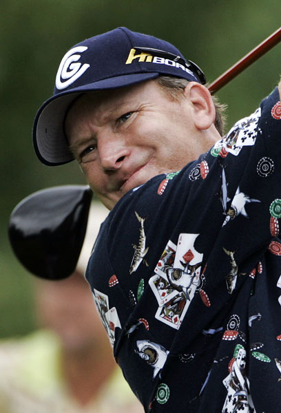 Woody Austin will be paired with Woods on Saturday. Austin shot a second straight 65.