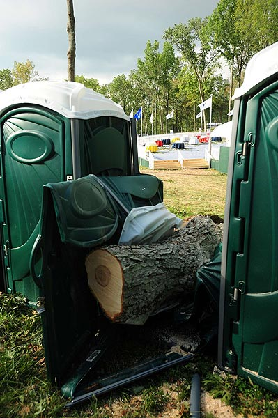 The portable toilet area was hit with several large trees.