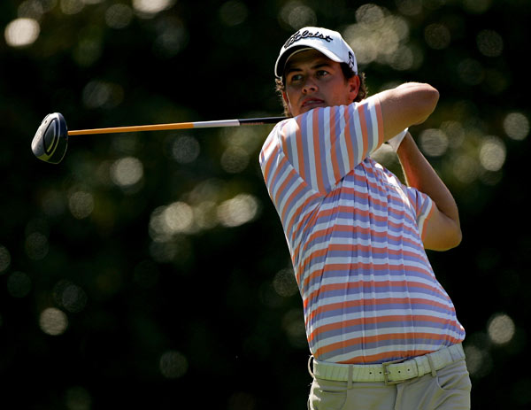Defending champion Adam Scott struggled to a one-over 71.