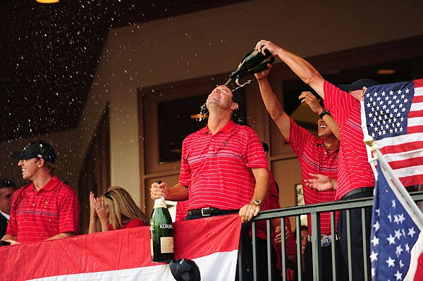 Team captain Paul Azinger got a champagne bath from his players after the matches were done.