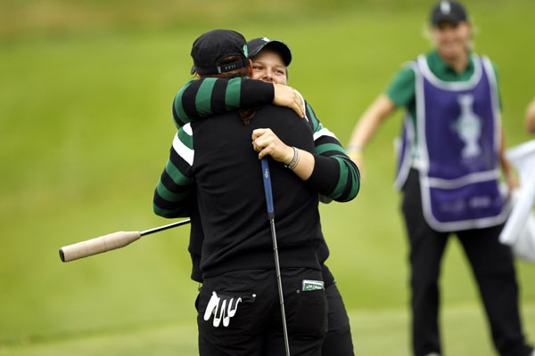 Caroline Hedwall, right, hugs Sophie Gustafson after they beat Vicky Hurst and Brittany Lincicome, 5 and 4. Europe leads 3 1/2 - 2 1/2 heading into Saturday.