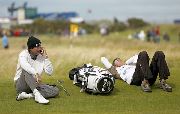 Bubba Watson made a phone call while his caddie, Ted Scott, took a break during a delay at the 2010 British Open.