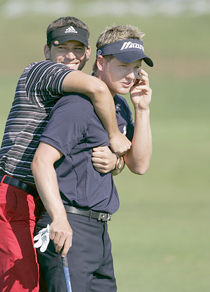 Sergio Garcia...Well, we don't really know what he's doing, but Luke Donald is trying to talk on the phone, Sergio!