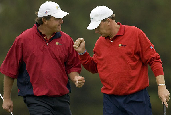 Presidents Cup: Day One                                              Phil Mickelson and Woody Austin halved their match after trailing three down against Vijay Singh and Mike Weir.