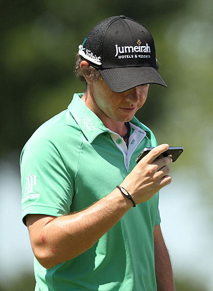 Rory McIlroy checked his phone during a practice round at the 2011 PGA.
