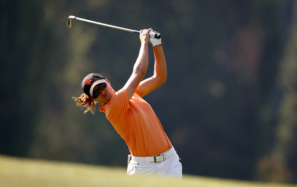 by four strokes on Sunday to win her first title in six years.
