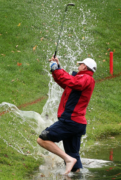 Playing partner David Toms also hit into the water, so it was up to Austin to try and win the hole for the U.S.