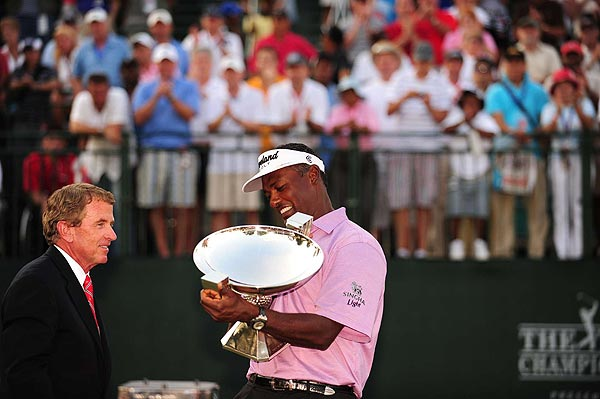 Vijay Singh, who finished at nine over par, was also awarded a trophy during the ceremony after the tournament -- for winning the FedEx Cup competition.
