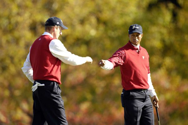 The Presidents Cup: Saturday Foursomes                                      Tiger Woods and Jim Furyk were hammered on Friday, but on Saturday morning they rebounded with a 4-and-3 rout of Ernie Els and Adam Scott.