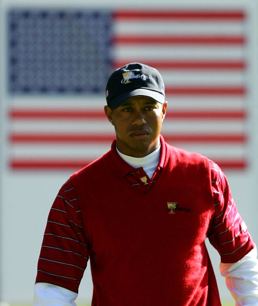 Tiger Woods dropped a 42-foot putt to beat Nick O'Hern and Geoff Ogilvy 5 and 3.