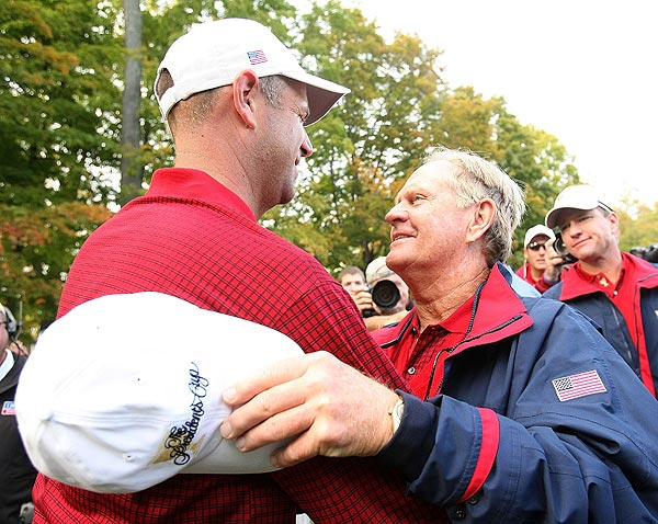 Stewart Cink was congratulated by Nicklaus. Cink birdied seven of his first eight holes and defeated Nick O'Hern, 6 and 4, to clinch the Cup for the Americans.
