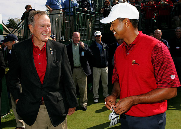 Final Day of the Presidents Cup                       Tiger Woods with former President George H. W. Bush on Sunday.