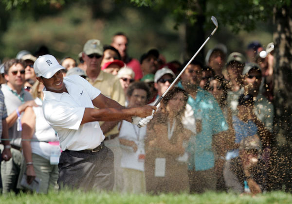 Woods bogeyed No. 12, but rebounded with birdies on 14 and 15 to shoot a six-under 65.