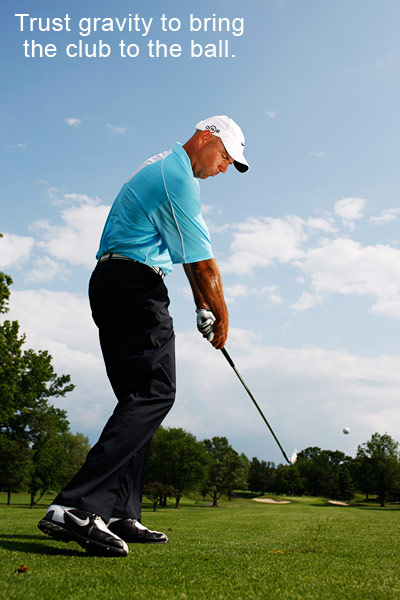 "Stewart Cink: How to Hit All-Feel, No-Think Shots                                              2. IRON SHOTS                                              Iron shots are all about predictability and distance control. And the only way you can hit predictable shots is to make solid contact. These three iron keys will help you make solid contact, so all you need to do is pick the right club to start making more birdies.                                              MY KEYS TO APPROACH SHOTS                                              1. Ball back in stance At address, keep the ball slightly back in your stance to encourage a downward strike at the ball.                                              2. Patient at the top You need patience to make a smooth transition from your backswing to your downswing. If your transition at the top is too fast, you'll lurch at the ball from your shoulders, causing all sorts of misfires. Instead, be patient at the top and trust gravity to bring the club back to the ball and keep your swing on plane. ""Big"" and ""slow"" are the key words to associate with all your swings.                                              3. Know your distances If you can keep your swing big and wide, and make a smooth transition, you'll start making consistent contact. So learn your exact iron yardages so you'll know precisely where all your shots are going."