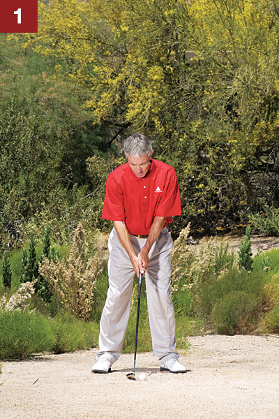 HOW TO MAKE CLEAN CONTACT FROM BARE LIES                                              STEP 1                                              Position the ball just forward of the middle of your stance and hover the club above the dirt. Set your weight so that it slightly favors your left side. If your weight is too far forward, you'll swing too steeply and slam the club into the hardpan.