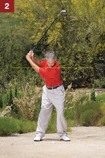 STEP 2                                              You have plenty of club, so make a comfortable three-quarter backswing. If you swing any harder, you'll lose your footing (which isn't that great to begin with since your spikes can't dig into hardpan). As you swing back, feel like your body is turning but your chest isn't swaying — just turning.