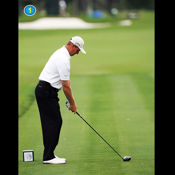 At address, Ernie keeps his arms as soft as possible and kinks his right elbow slightly. This allows him to start the club back by hinging his wrists and bending his right elbow.