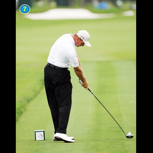 Check Ernie's left hip — it's higher than his right. He pulls it up and to the left using his powerful glutes. His arms and clubhead have no other option but to follow at breakneck speed.
