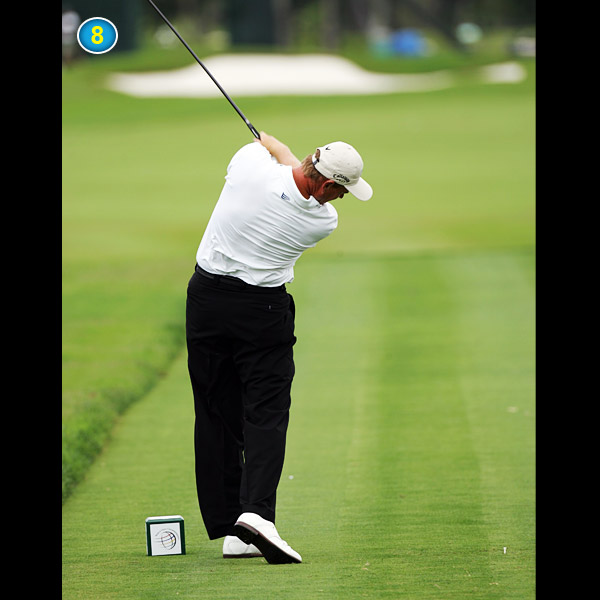 The club exits on a plane much like the one it took going back. This determines the accuracy of any shot. For best results, point the back of your right hand at the sky during your release.