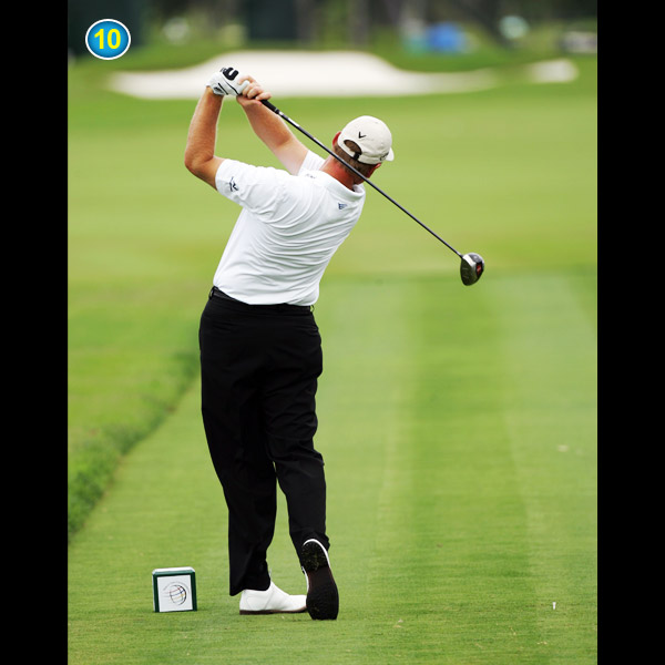 Any golfer who slices or has difficulty drawing the ball should copy this position. Feel like you're bending your elbows and throwing the club over your left shoulder in your follow-through.