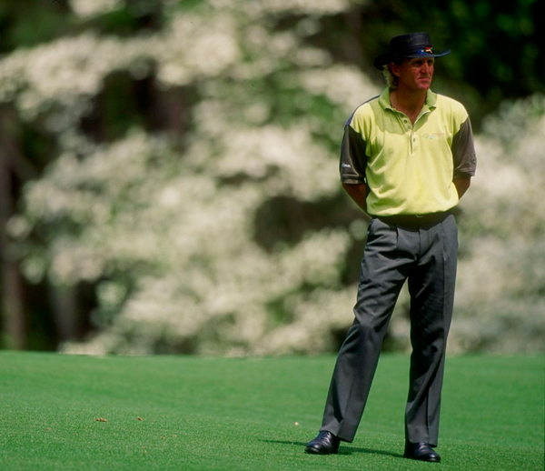 """1980s                                          The Reagan era kicked off with Caddyshack. Curiously, the slapstick comedy paralleled a revival of interest in golf and a return to tradition in clothing, with a technological twist: stretch fabrics; moisture-wicking shirts; and waterproof leathers. In 1989, Footjoy introduced DryJoys, a traditional golf shoe with waterproof leather. Golfers stepped into designer clothes. No one embodied this change more than Greg Norman, who left his mark with big hats, bold colors, and his own """"Shark"""" clothing line."""