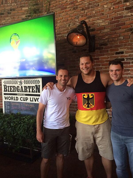 @TheSergioGarcia:At the Biergarten in NYC with Martin the new US Open Champ, watching Germany vs Portugal! Good run for the Germans!