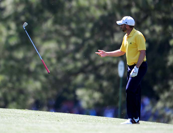 Sergio Garcia throws his club after a poor approach shot on No.17 during Friday's second round of the Masters Tournament at Augusta National Golf Club on April 6, 2012.