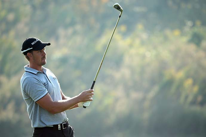 Henrik Stenson hits his second shot on the third hole during the final round of the BMW Masters at Lake Malaren Golf Club on Oct. 27, 2013 in Shanghai. Stenson, who is dealing with an injured wrist, finished T34.
