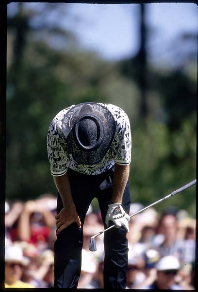 The body language said it all as Greg Norman blew a six-stroke lead letting Nick Faldo capture the 1996 Masters. Here, Norman hangs his head after hitting on 4th tee. This photo was used on the April 22, 1996, Sports Illustrated cover.