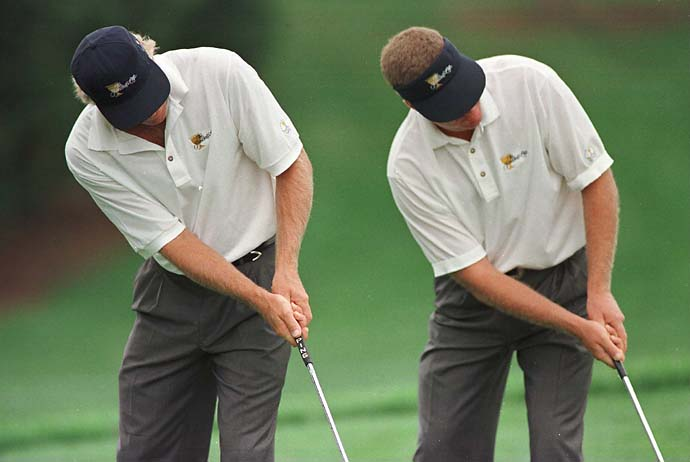 Greg Norman and Steve Elkington playing for the International Team practice take putts during the practice round for the 1996 Presidents Cup at Robert Trent Jones Golf Club in Manassas, Va.