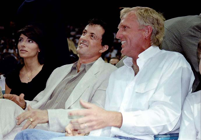 Sylvester Stallone and Greg Norman watch the Miami Heat-Chicago Bulls Eastern Conference finals Game 3 with Stallone's wife Jennifer Flavin on May 24, 1997, in Miami