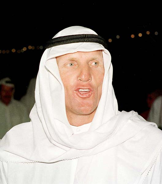 NORMAN OF ARABIA: Greg Norman, dressed in the traditional thobe, enjoys an Arabian Nights excursioni n the middle of the desert after the third day of the Dubai Desert Classic in Dubai, United Arab Emirates, in March 1997.