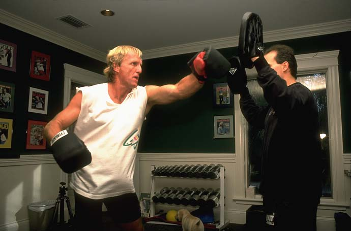Greg Norman boxing and working out in his gym with personal trainer Pete Draovitch in February 1997.