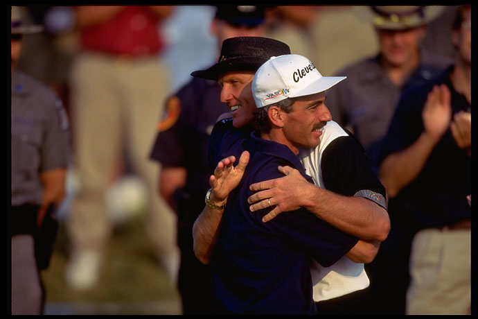 A gracious Greg Norman hugs 1995 U.S. Open champion Corey Pavin on the 18th green at Shinnecock.