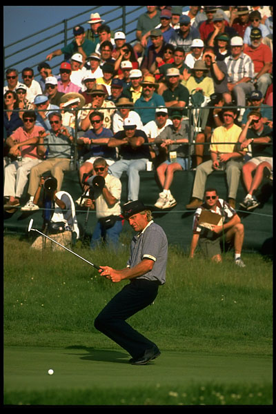 Greg Norman tries to put some body english on a putt at the 1995 U.S. Open at Shinnecock.