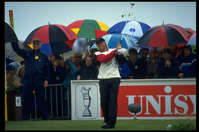 Greg Norman drives in the rain at Royal St. Georges in the 1993 British Open.