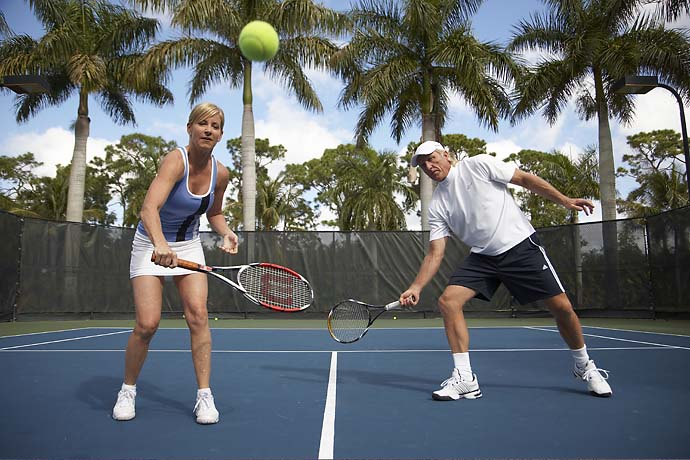 Greg Norman plays tennis with then-wife Chris Evert at Evert's house in Florida in January 2009.
